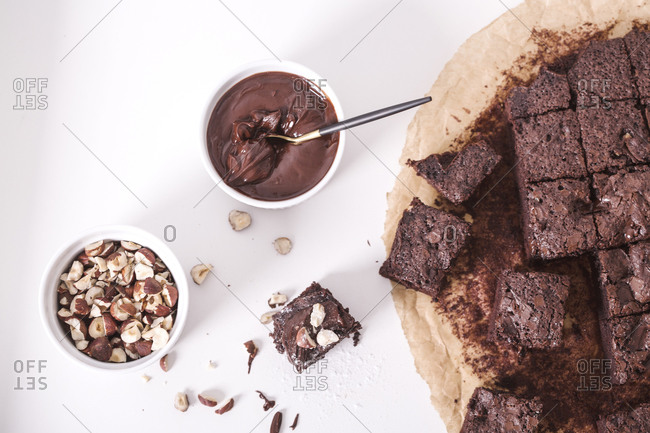 Overhead view of homemade brownie with roasted hazelnuts and melted chocolate