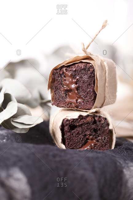 Homemade brownie with roasted hazelnuts and melted chocolate stacked and wrapped in paper and twine