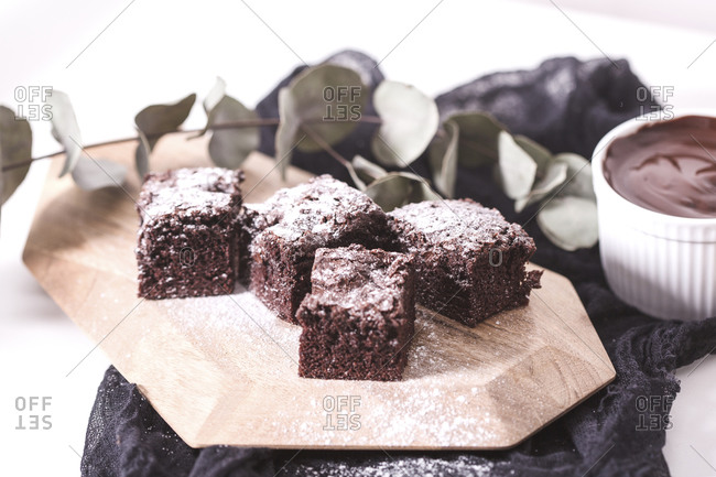 Homemade brownie with powdered sugar and melted chocolate