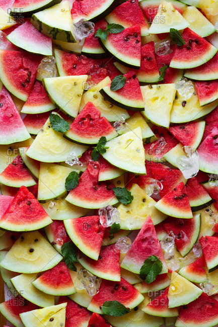 Organic pink and yellow watermelon with ice and mint leaves