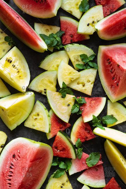 Fresh sliced organic watermelon on dark background