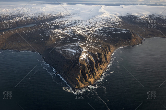 Rocky cliffs on the coast of Iceland in winter