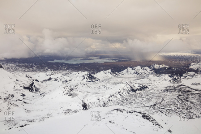 Bird's eye view over snowy Icelandic mountains
