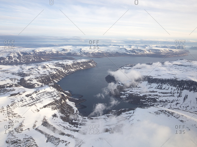 Bird's eye view over Icelandic mountain landscape and sea