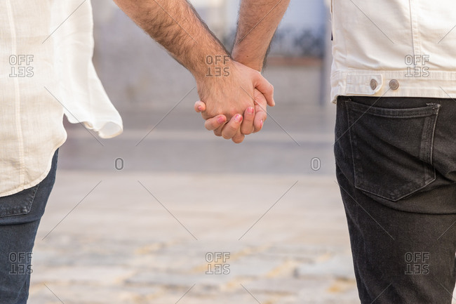 Unrecognizable gay couple love outdoors concept