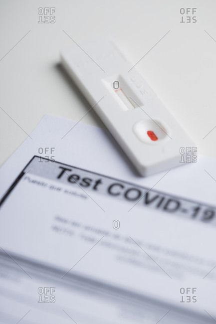 Closeup of results of express blood test on coronavirus placed on medical report in clinic