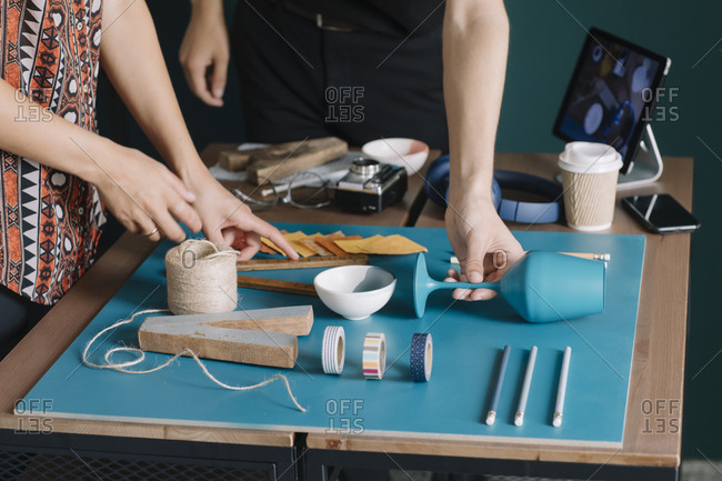 Close-up of creative couple arranging decoration on table