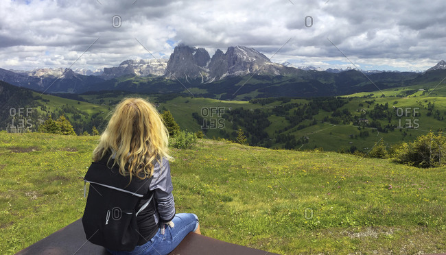 Italy- South Tyrol- Seis am Schlern- Blonde woman admiring scenic landscape of Seiser Alm