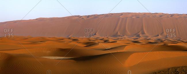 United Arab Emirates- Emirate ofAbuDhabi- Sand dunes at Quarter desert at sunset