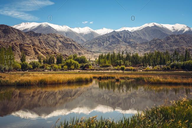 India- Ladakh- Leh- Himalayas reflecting in shiny lake