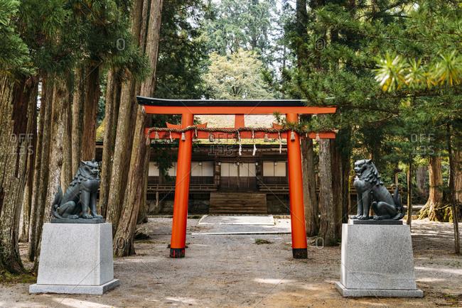 Statues besides torii gate at Koyasan- Japan