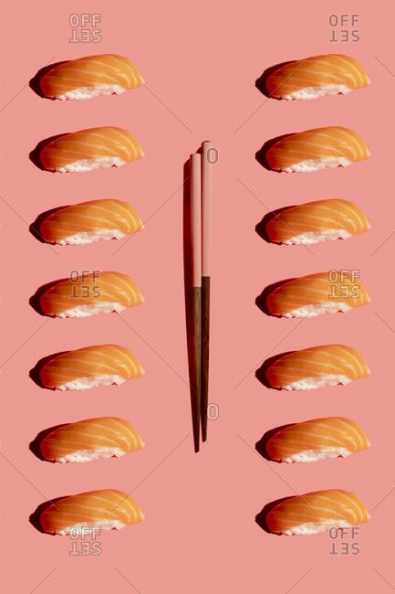 Studio shot of chopsticks and salmonnigirizushipieces