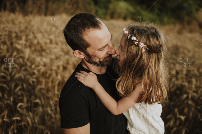 Father and daughter making wonderful memories together in wheat farm