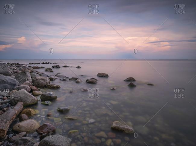 Germany- Mecklenburg-Western Pomerania- Rocky shore of Rugen island at dusk