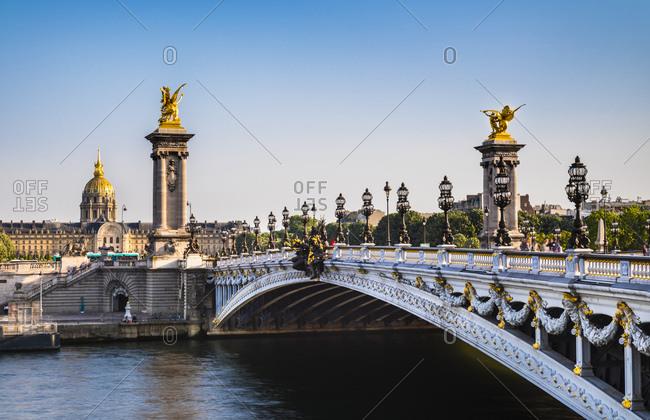 Bridge Alexandre III over Seine river against clear blue sky in Paris- France