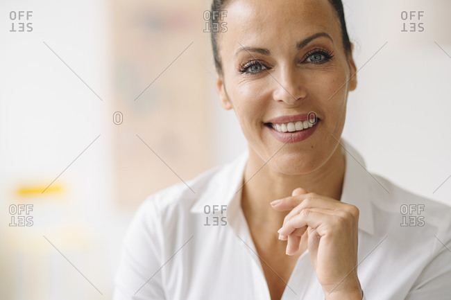 Smiling businesswoman in home office