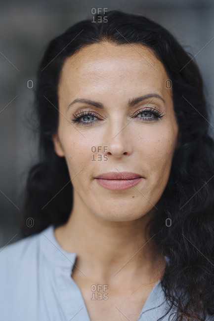Close-up portrait of beautiful woman with gray eyes