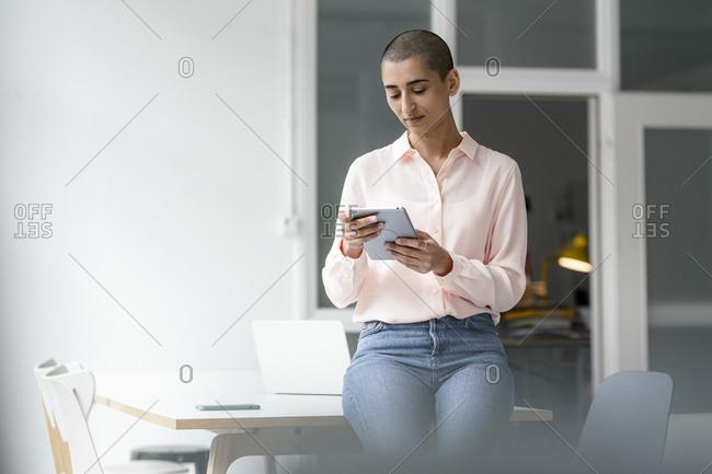Woman using tablet in loft office