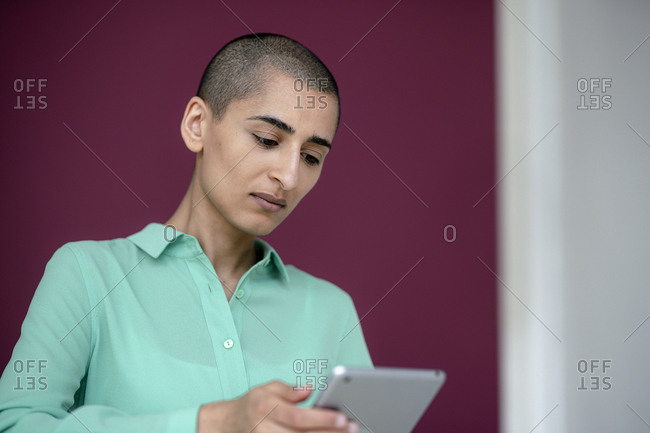 Portrait of focused businesswoman using tablet