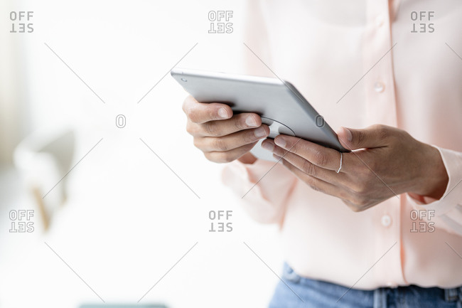 Close-up of businesswoman using tablet