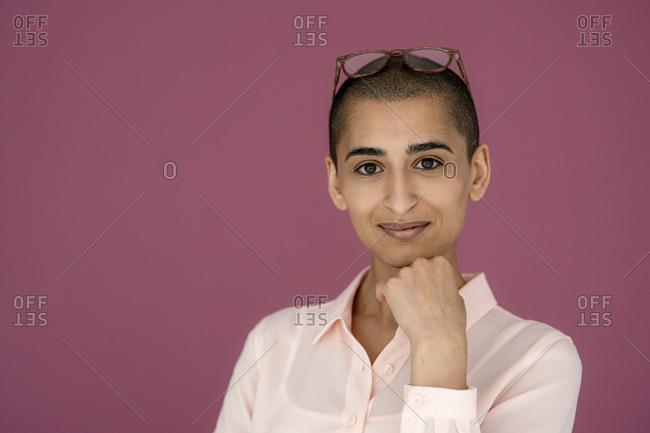 Portrait of a confident woman with purple background