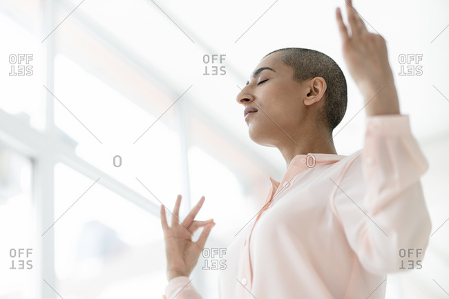 Portrait of woman with short hair and closed eyes meditating