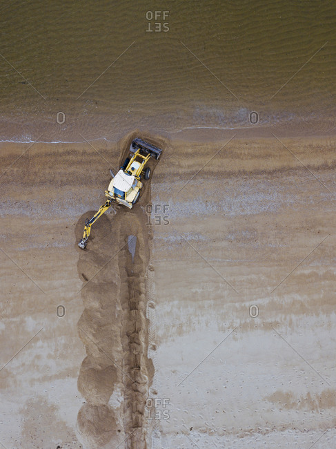 Tractor on beach- aerial view