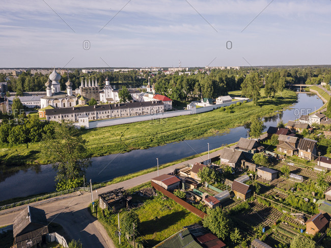 Russia- Leningrad Oblast- Tikhvin- Aerial view of Tikhvinka river bending in front of Tikhvin Monastery Of Dormition Of Mother Of God
