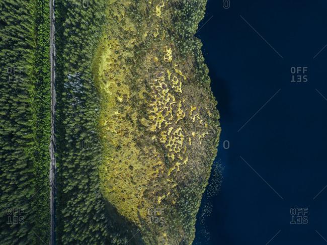 Russia- Petrozavodsk Oblast- Karelia- Railroad track near forest lake- aerial view