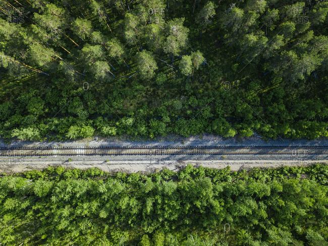 Russia-PetrozavodskOblast-Karelia- Railroad track crossing forest- aerial view
