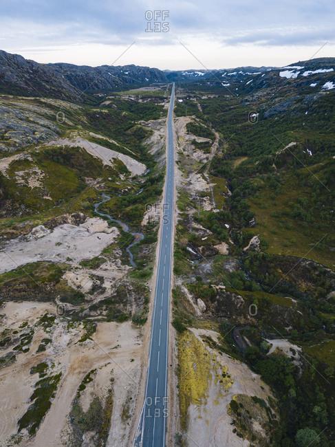 Russia- Murmansk Oblast- Teriberka- Aerial view of straight asphalt road across mountainous landscape