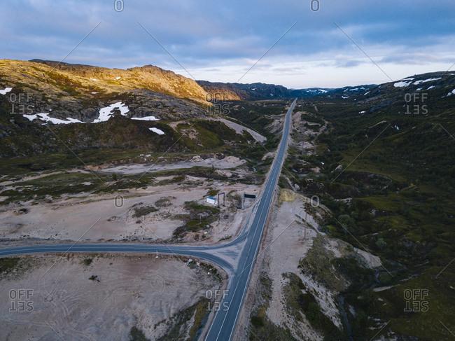 Russia- Murmansk Oblast- Teriberka- Aerial view of intersection of straight alpine road