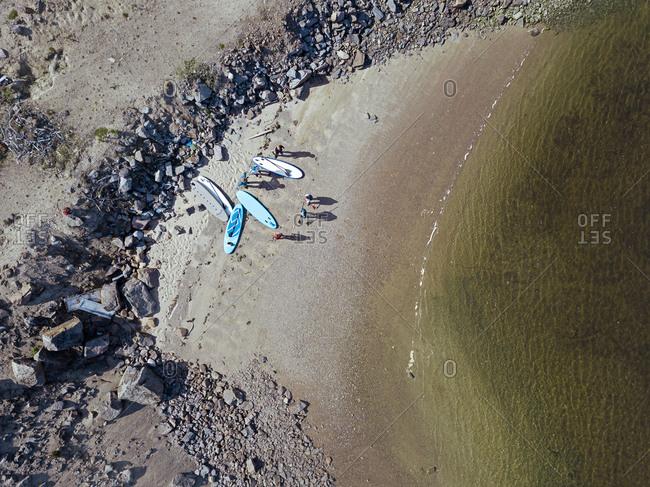 Aerial view of surfers on sandy bank of Teriberka River