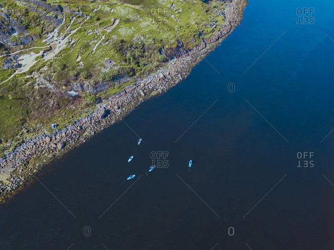 Aerial view of people surfing along bank ofTeriberka River
