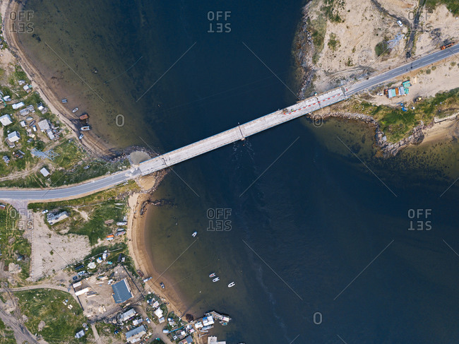 Russia- Murmansk Oblast- Teriberka- Aerial view of coastal village bridge