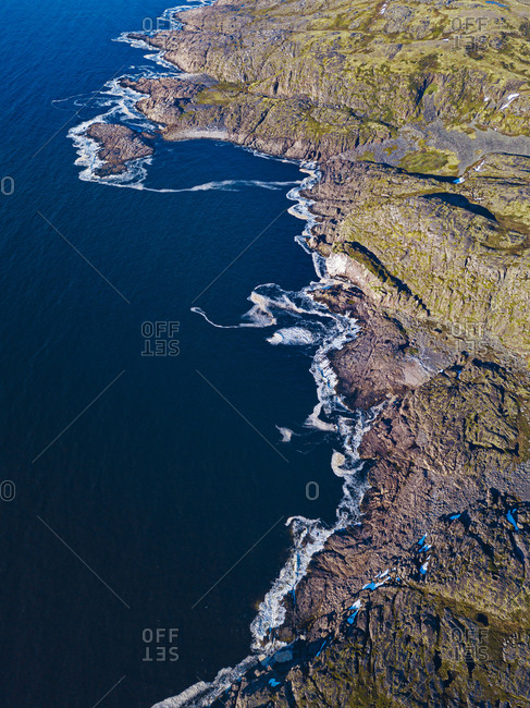 Russia- Murmansk Oblast- Teriberka- Aerial view of rocky coastline of Barents Sea