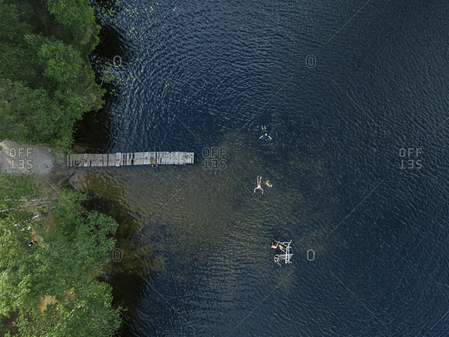 Aerial view of group of people swimming in lake