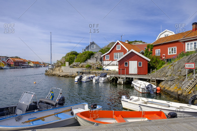 Sweden- Vastra Gotaland County- Kyrkesund- Motorboats moored in fishing village