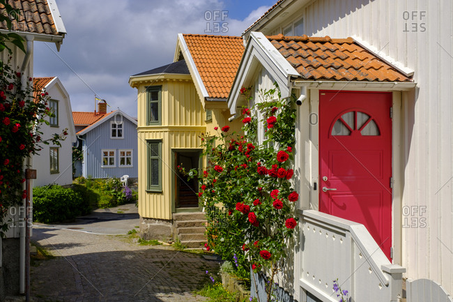 Sweden- Vastra Gotaland County- Fiskebackskil- Flowers blooming in front of cottage entrance door in summer