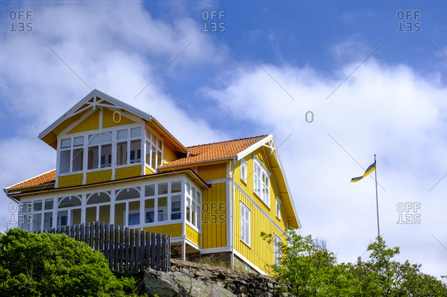 Sweden- Vastra Gotaland County- Fiskebackskil- Yellow painted cottage in summer