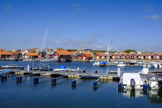Sweden- Vastra Gotaland County- Vajern- Boats moored in marina of coastal town in summer