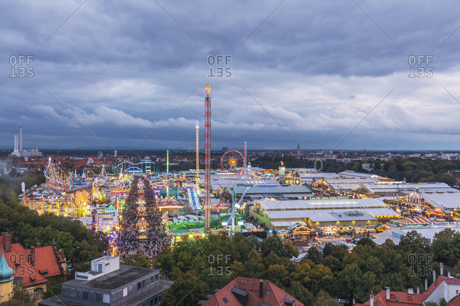 May 29, 2020: Germany- Bavaria- Munich- Drone view of clouds over crowded amusement park duringOktoberfest