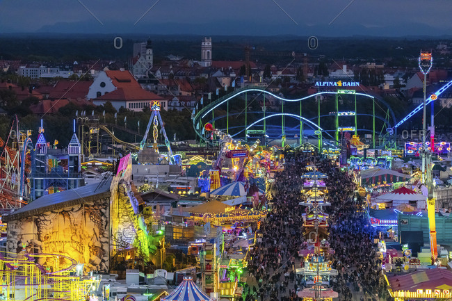 May 29, 2020: Germany- Bavaria- Munich- Drone view of crowds of people celebratingOktoberfest in vast amusement park at dusk