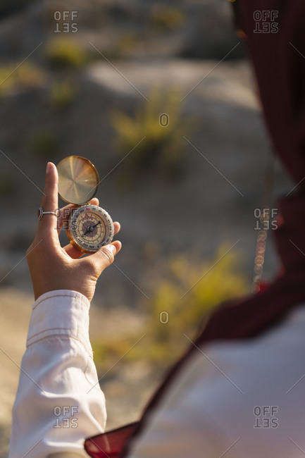 Close-up of woman holding a compass
