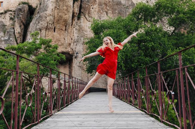 Ballerina dancing on Saint Paul Bridge in Cuenca- Spain