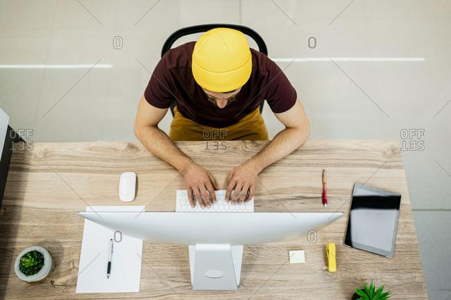 Businessman using computer desk in modern office