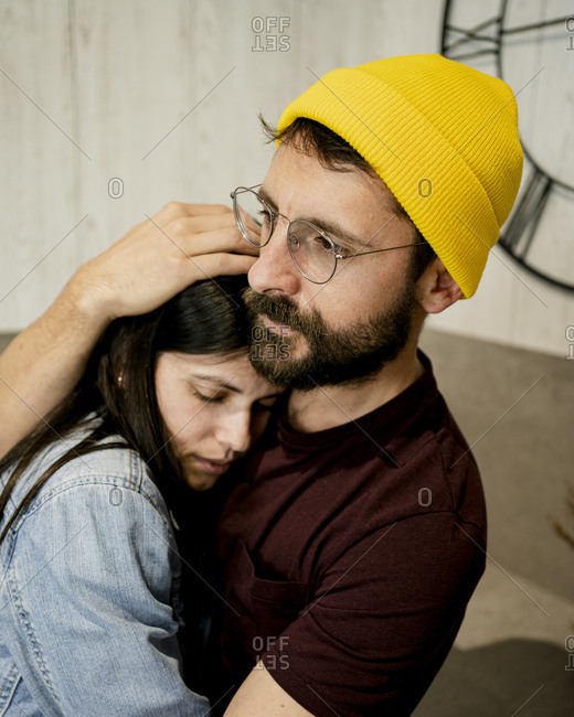 Affectionate couple embracing at home
