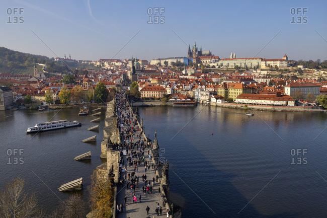 Czech Republic- Prague- People walking along Charles Bridge