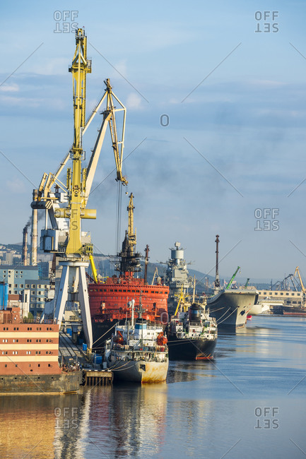 July 31, 2018: Russia- Murmansk- Industrial ships and cranes at dock