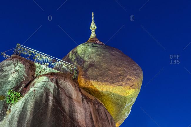 Myanmar- Mon state- Kyaiktiyo Pagoda- Golden rockat night- low angle view